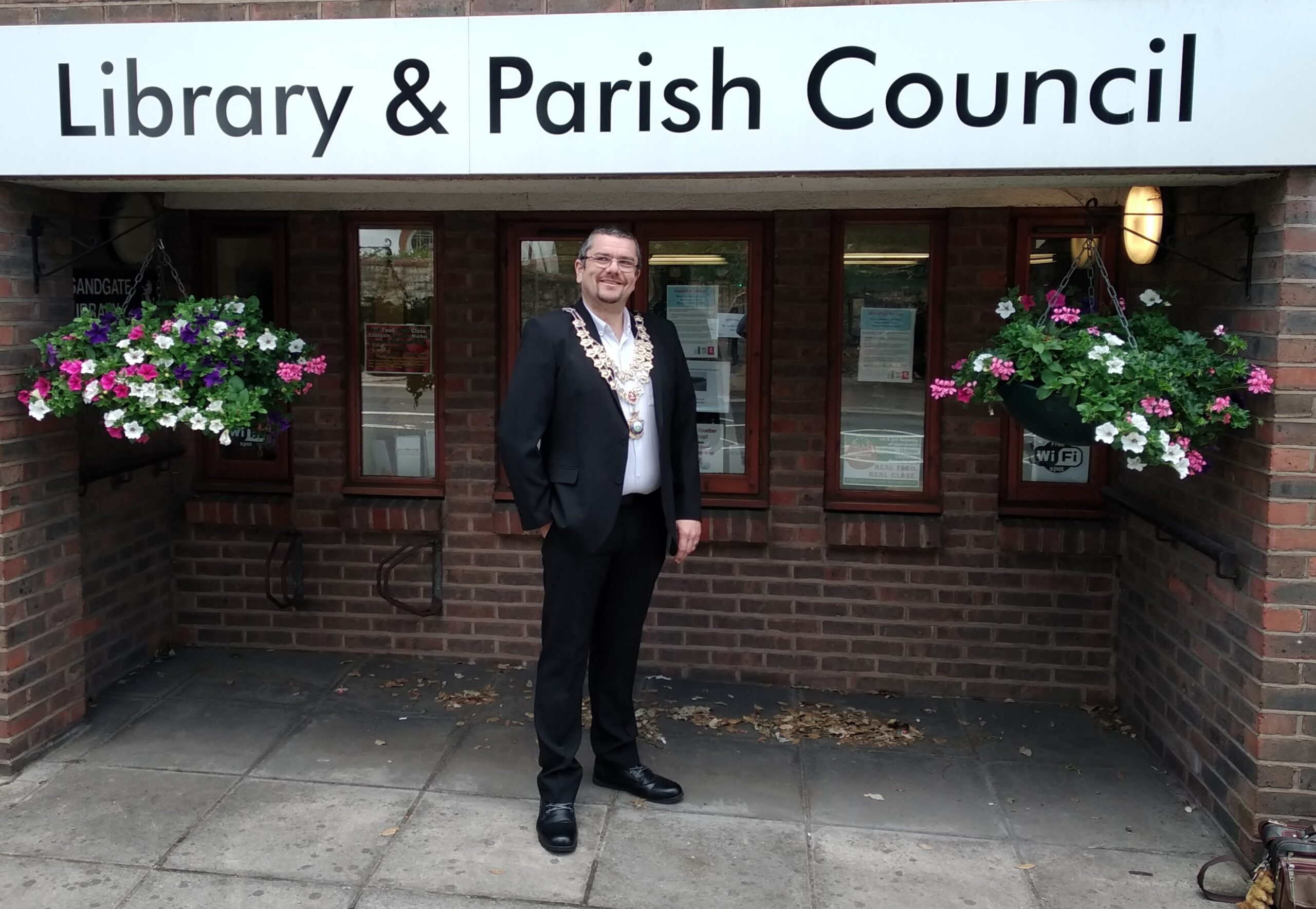 Tim Prater outside the Library and Parish Council office