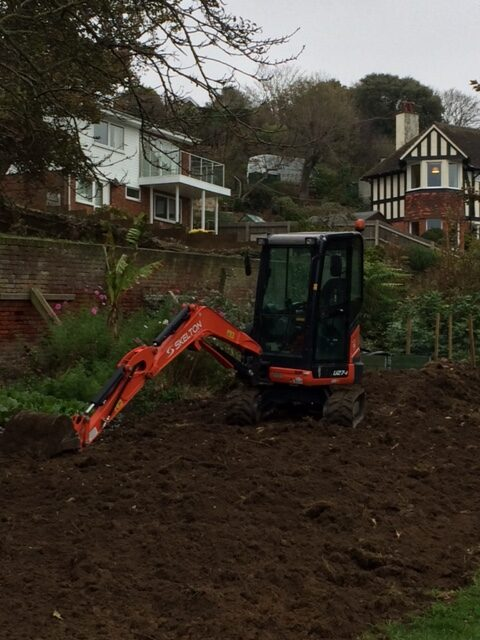 Digging out the Garden / mechnical digger